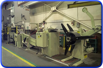 Conventional Coil Feed Line with Powered Straightener, Pull-Off Reel and ServoMax Servofeed.